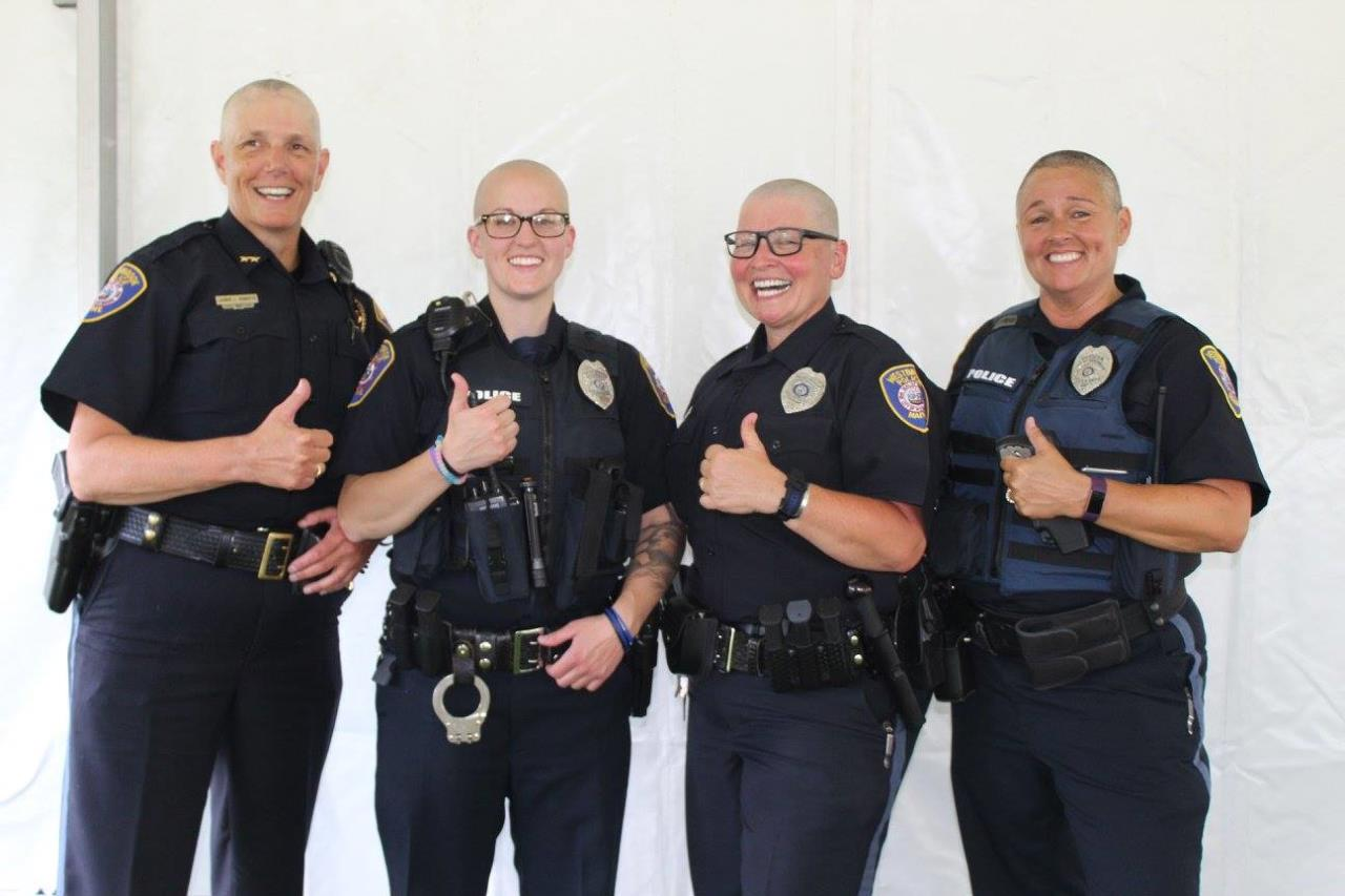 Female Officers With Freshly Shaved Head Stand Together for Brave the Shave Fundraiser Event